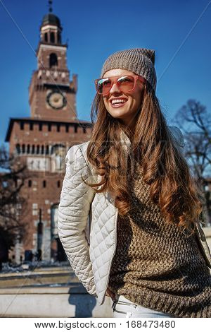Smiling Woman Near Sforza Castle In Milan, Italy Looking Aside