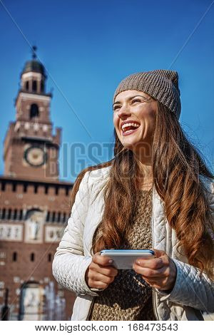 Smiling Young Woman In Milan, Italy Writing Sms
