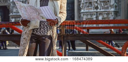 Rediscovering things everybody love in Milan. Full length portrait of smiling modern tourist woman in fur coat and sunglasses in Milan Italy with map looking into the distance