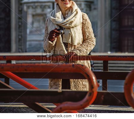 Tourist Woman Looking Into Distance While Holding Photo Camera