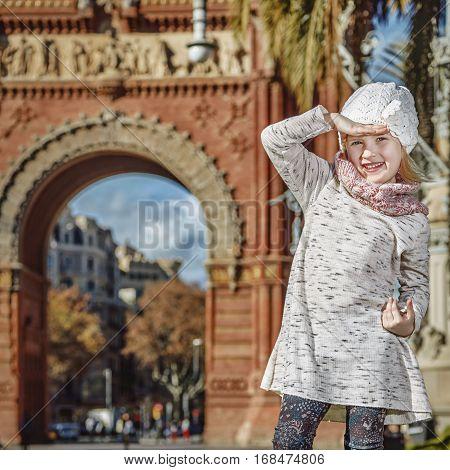 Girl Near Arc De Triomf In Barcelona Looking Into Distance