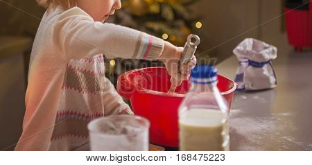 Baby Kneading Dough In Christmas Decorated Kitchen