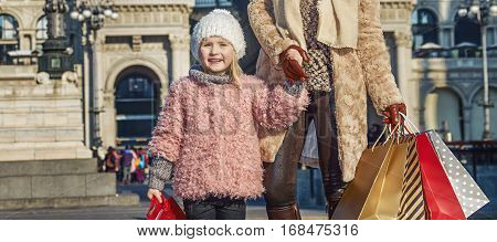 Rediscovering things everybody love in Milan. Full length portrait of elegant mother and daughter travellers with shopping bags near Galleria Vittorio Emanuele II in Milan Italy