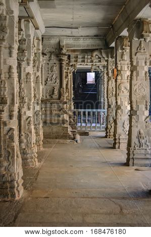 Columns with the frescoes in the Shiva Virupaksha Temple. There is the famous Indian landmark located in the ruins of Vijayanagar at Hampi, India. Selective focus
