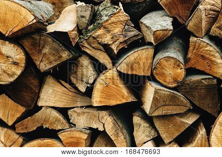 Natural Stocked Firewood In A Pile, Wooden Abstract Background, Energy Enviroment Concept