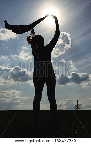 Silhouette Of Stylish Girl Holding Scarf In The Windy Evening Outdoors In Spring Field, Life Success