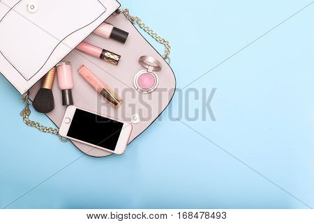 Set of decorative cosmetics on blue background. flat lay
