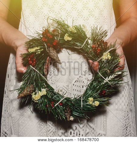 Boho Woman Holding Christmas Wreath In Hands In Light, Seasonal Holidays, Rustic Theme, Adorning