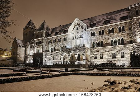 The Neo-Romanesque building of the Imperial Castle at night in Poznan