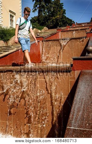Happy Stylish Hipster Man Playing With Water In Fountain, Having Fun, Summer Vacation
