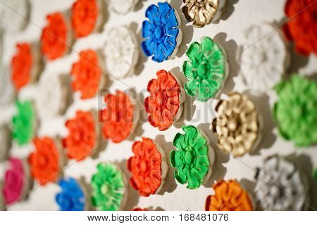 plaster rosette stucco in the form of flowers leaves and flowers. backround. close up
