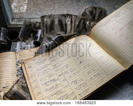 PRIPYAT, UKRAINE - OCTOBER 24, 2016: Radiograms (chest x-rays) and a book lying in the ghost town Pripyat in the Chernobyl Exclusion Zone which was established after the nuclear disaster in 1986