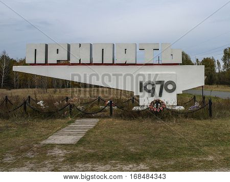 PRIPYAT, UKRAINE - OCTOBER 24, 2016: Town sign of the abandoned city of Pripyat in the Ukraine the city is located in the Chernobyl Exclusion Zone which was established after the nuclear disaster