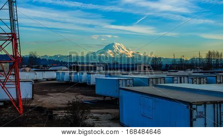 A view of shipping containers and Mount Rainier. HDR image.