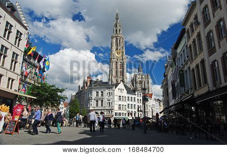 Antwerpen, Belgium - May 24, 2014. Onze-Lieve-Vrouwekathedraal cathedral on Groenplats square in Antwerpen, with surrounding historic buildings, commercial properties and people.