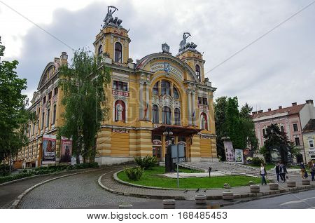 Cluj Napoca, Romania - May 1, 2014: National Romanian Theater and Opera House in Cluj Napoca city in the Transylvania region of Romania in a baroque architectural style