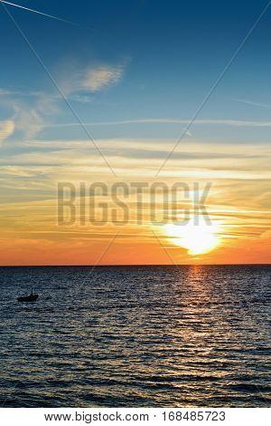 Sunset time on beach  near Budva, Montenegro. Balkans, Adriatic sea, Europe.