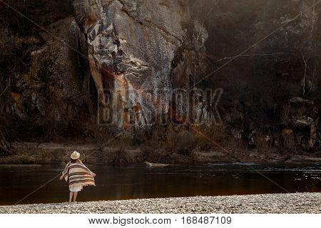Beautiful Woman Traveler  Wearing Hat And Poncho, Looking At Amazing Cliff, Boho Travel Concept, Mag