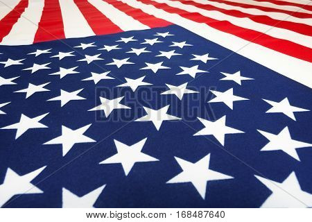 Close-up picture of American flag laying on flatness and going forward