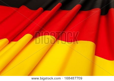 Picture of textile pleated flag of Germany laying on flatness