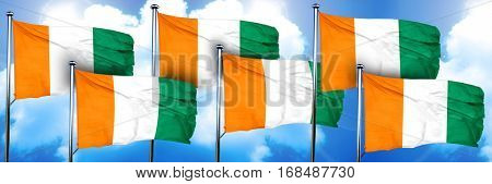 Ivory coast flags, 3D rendering, on a cloud background