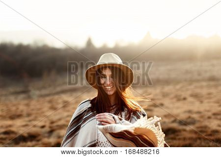 Happy Boho Woman Hipster, Smiling At Sunset In Mountains, Wearing Hat And Poncho, True Emotions, Spa