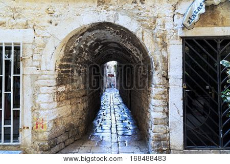 SPLIT, CROATIA - SEPTEMBER 11, 2016: This archway one of the streets of the old town which is located on the territory of the Diocletian's Palace.
