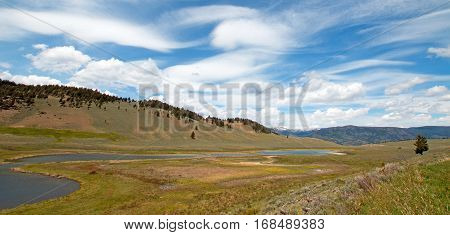 Blacktail Lakes under cirrus lenticular cloudscape in Yellowstone National Park