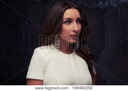 Close-up portrait of delighted pretty female with mouth open slightly and languishing look while posing at the camera. Looking into direction