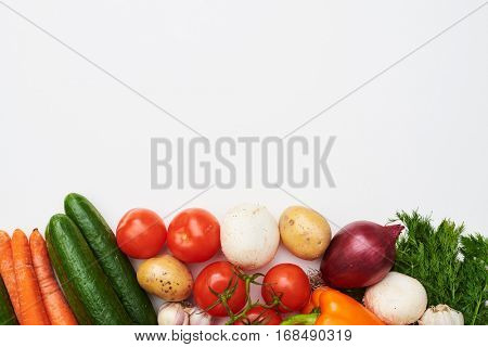 Overhead shot of raw organic vegetables with fresh ingredients for healthily cooking on. Vegan or diet food concept. Background layout with space