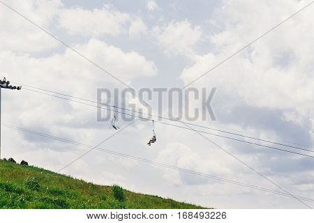 Old Chairlift Hoist In Sunny Summer Mountains Under Blue Sky And Clouds, Amazing View, Travel Concep