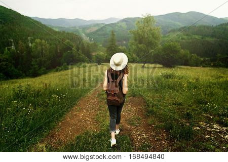 Woman Traveler With Backpack And  Hat Walking In Amazing Mountains And Forest, Wanderlust Travel Con