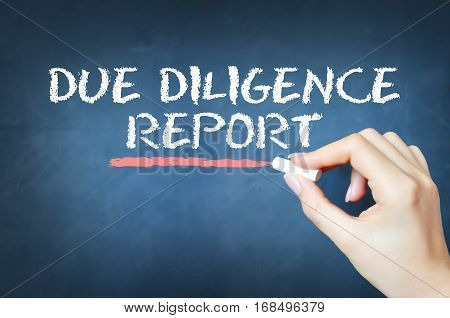 Due diligence report text written with chalk on blackboard