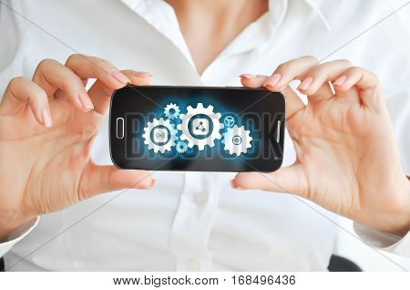 Using mobile devices resources and capabilities with mobile phone or smartphone with spinning gears on display