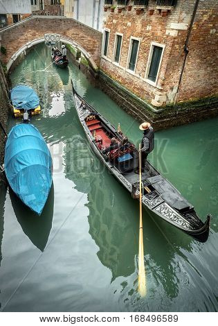 Venice. Gondoller and gondolas in one of popular romantic place in the world on the street in Venice, Italy.
