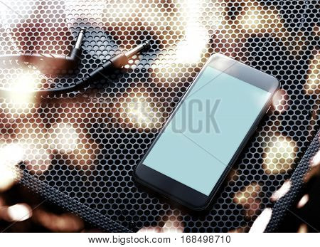 Template of black modern smartphone turned right with audio speaker background. Clipping path