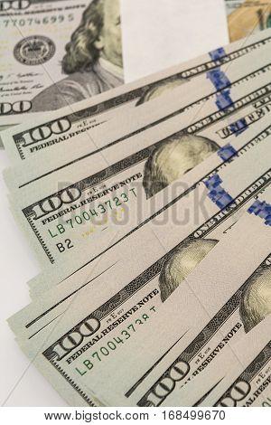 Stack of cash money in hundred dollar banknotes