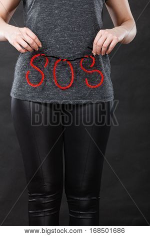 Woman Holding Red Sos Sign, She Need Help