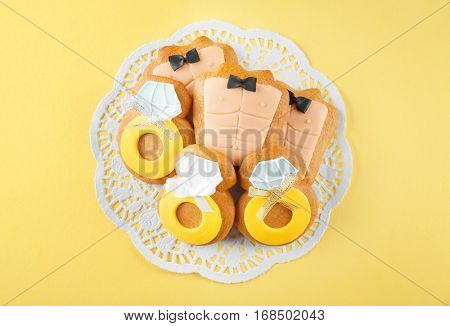 Bachelorette party cookies on color background