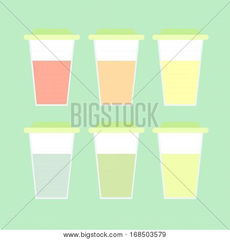 A set of translucent closed glasses with colorful lemonade. The drink for summer walks and picnics