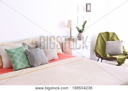 Interior of modern bedroom with cozy double bed