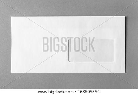 Blank white envelope on grey background