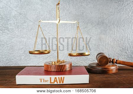 Scales of justice on book, closeup