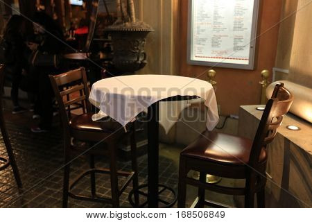 Empty table for two with white table cloth.