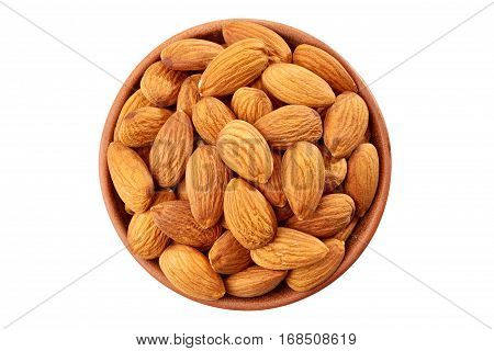 Peeling almond in ceramic bowl isolated on white background. Top view.
