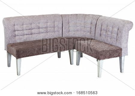 Corner banquette bench with backrest upholstered in a soft cloth isolated on white background with clipping path.