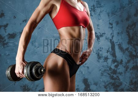 Muscular fitness woman, healthy lifestyle, Cross fit bodybuilder, athletic woman's body, close up of young woman with barbell flexing muscles