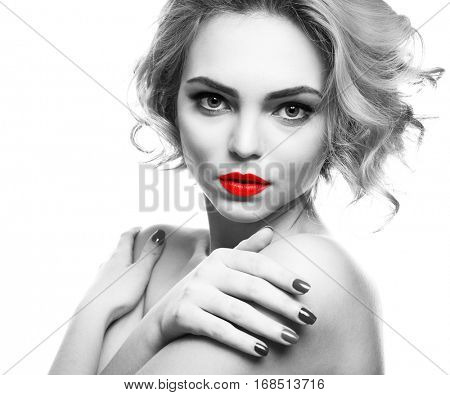 Young woman with color accent in makeup on white background