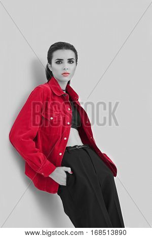 Young woman with color accent in makeup and fashion look on gray background