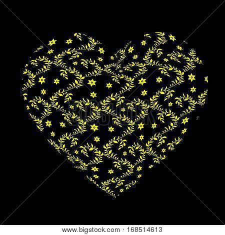 Yellow openwork pattern in the form of a large heart on the black background. Gift for Valentines day